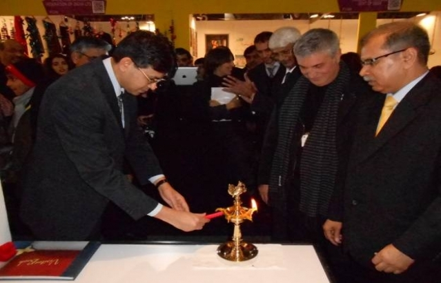 CG OF INDIA TO MILAN LIGHTING THE LAMP AT THE INAUGURATION OF THE INDIA PAVILION